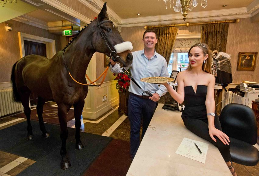 Pictured 'checking in' at the launch of Naas Racecourse's Lawlors Hotel Novice Hurdle was director of Lawlors and former Irish soccer star Niall Quinn along with race mascot Purty the horse and the ra